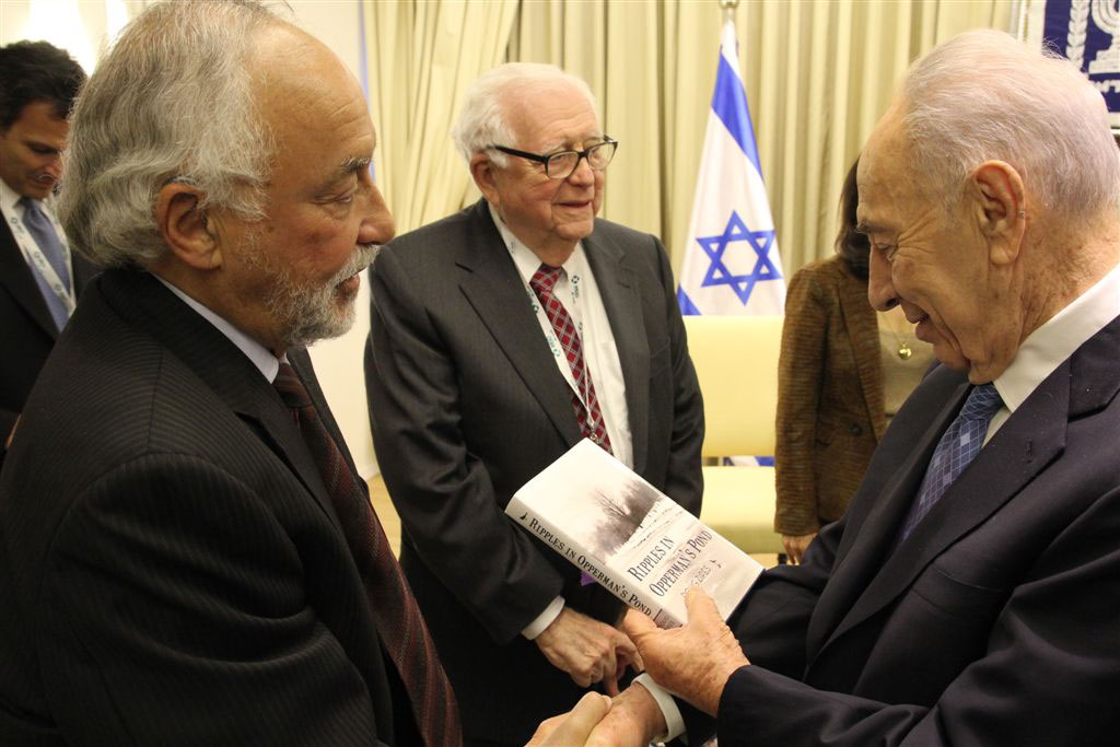 Israeli President, Shimon Peres, accepts copy of 'Ripples in Oppermans' Pond